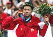 图文:林丹奥运对手陶菲克 印尼天才雅典夺金牌