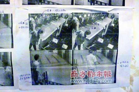 """网吧工作人员根据录像标出""""小偷""""及其所说""""台词""""。本报记者陈宇摄"""