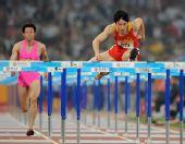 图文:刘翔首演13秒63晋级 将对手甩在身后