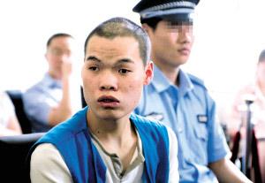 预谋用尸块敲诈业主的李海洋在法庭上。北京晨报