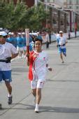 图文:圣火新疆喀什传递 168棒火炬手传递祥云