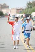 图文:圣火新疆喀什传递 175棒火炬手传递祥云