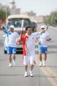 图文:圣火新疆喀什传递 183棒火炬手传递祥云