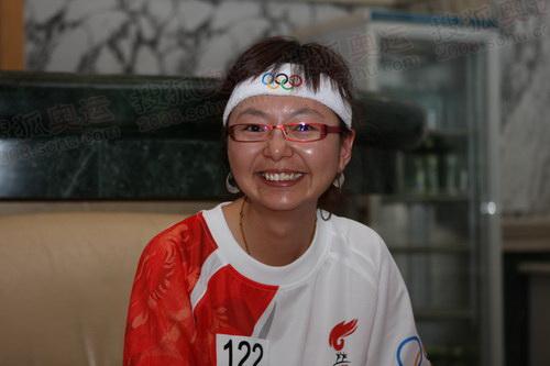 火炬手李清萍笑容灿烂、性格乐观