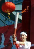 奥运圣火在齐齐哈尔市传递 第一棒火炬手刘艳