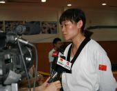 图文:中国跆拳道队进行教学表演 罗微接受采访