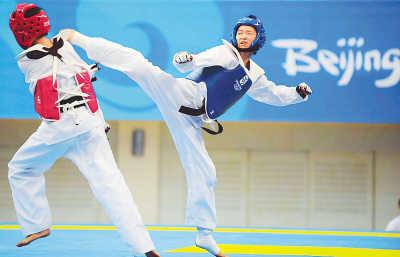 7月24日,中国跆拳道队在北京怀柔体育馆进行奥运会前的最后一次模拟赛场训练。