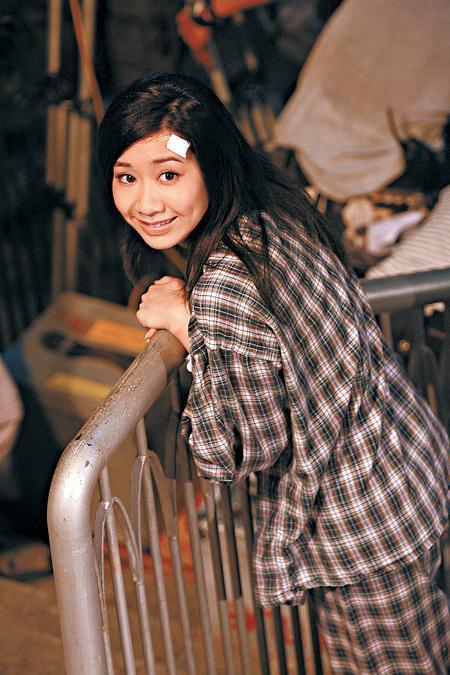 吴雨霏见记者拍照即笑容满面。