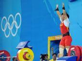 图文:女子69公斤级刘春红夺金 庆祝胜利