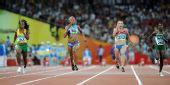 """图文:女子100米第二轮赛况 """"女飞人""""的争夺"""