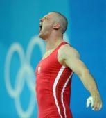 图文:男举94公斤级决赛 波兰选手摘得银牌怒吼
