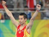 图文:奥运会男子鞍马肖钦夺冠  高举双臂
