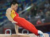 图文:奥运会男子鞍马杨威获第四 比赛动作