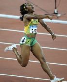 图文:牙买加选手夺100米金牌 开放的大笑伴随她