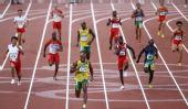 图文:男子4X100米接力牙买加队夺金 鲍威尔