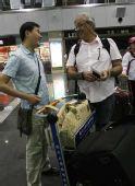 图文:杜伊悲情离开中国 与记者告别