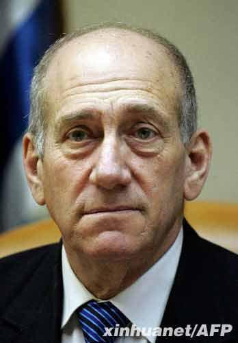这是2007年9月16日拍摄的以色列总理奥尔默特参加内阁会议的资料照片。新华社/法新