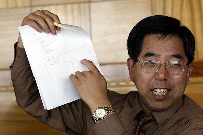 """现年50岁的马建堂被誉为中国经济学界年轻有为的""""官厅经济学家""""。章轲/CFP 资料"""