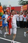 人物图片:李福成2008奥运火炬行(20)