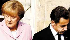 由于面临不同国内问题,参加小型峰会的各国领导人未能开出集体救市支票。图为德国总理默克尔、法国总统萨科齐。