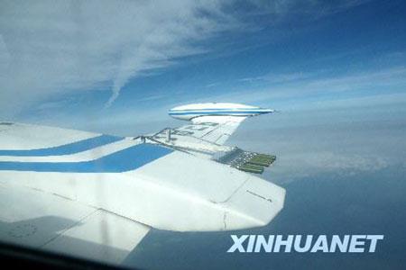 10月6日,飞机正在进行增雨作业。