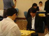 组图:智运会围棋男团半决赛 小李上阵长发遮眼