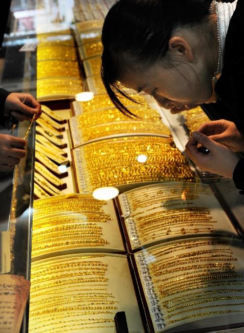 黄金价格下跌_青岛:黄金饰品价格持续下跌(组图)