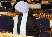 图文:国象奥赛最后一轮比赛 黑人女棋手带白帽