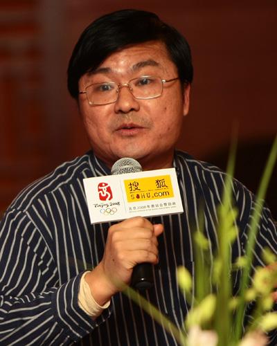 长江商学院教授周春生