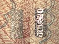 """第一种伪造安全线是在钞票正面,使用灰黑色油墨印刷一个深色线条,背面是用灰色油墨印刷开窗部分,无全息图文,或含有极模糊的 """"¥100""""字样,此类伪造安全线无磁性特征。"""
