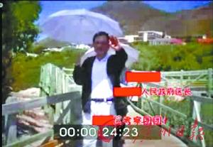端州区长谭日贵(视频截图)