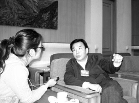 全国人大代表、重庆市市长王鸿举接受了本报记者独家专访 本报特派记者 王远凌 摄