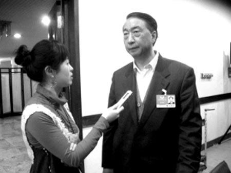 本报记者专访教育部副部长章新胜