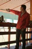 图文:男子50米手枪慢射决赛 石兴隆在比赛中