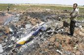 目击者称客机突然从空中坠落 撞击地面爆炸(图)