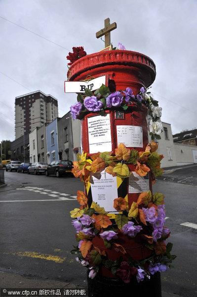 创意无极限!英国废弃邮筒变身公共艺术品(组图)图片