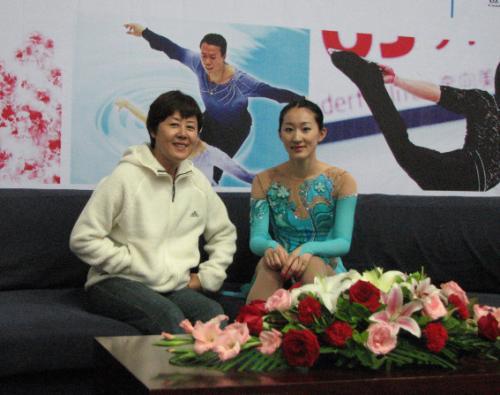 刘艳与教练赛后合影