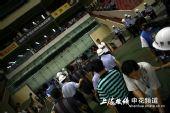 图文:[中超]上海VS长春 何志彪离去留下背影