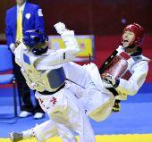 图文:11运跆拳道男子68KG级唐华夺冠 对手怒吼