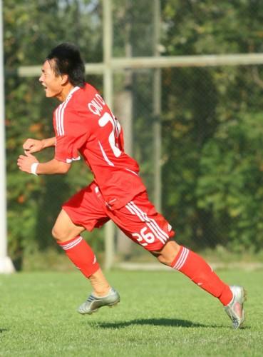图文:[亚少赛]国少VS新加坡 邱达明庆祝进球