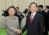 温家宝昨日在平壤同朝劳动党总书记金正日会谈