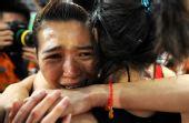图文:女子4X400米接力广东队夺冠 激动落泪
