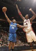 图文:[NBA]魔术战胜猛龙 波什封盖尼尔森