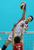 图文:东亚运中国男排胜中国香港 仲为君扣球