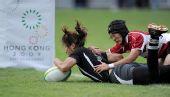 图文:橄榄球中国女队夺冠 中国队球员管奇仕