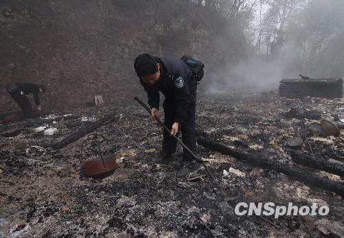 湖南/组图:湖南杀人纵火案嫌犯被抓犯罪现场成废墟