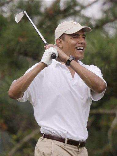 奥巴马帅气挥杆
