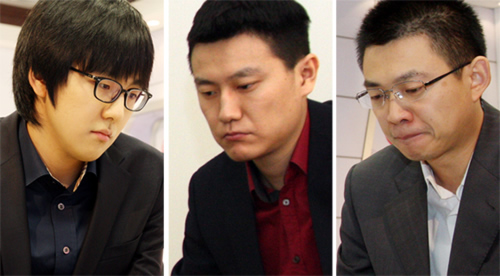 金志锡、孔杰和丁伟(从左至右)晋级16强