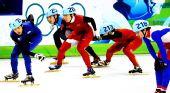 图文:中国获男子5000米接力第四 进行交接棒