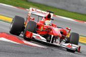 图文:2010赛季前F1试车结束 马萨过弯瞬间